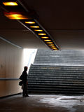 Rain. Women free of umbrella wait in urban tunnel royalty free stock photos