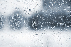 Rain. Drops on the glass window. Blurred background Stock Image