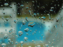 Rain. On the window with pool in the background Stock Images