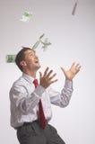 Rain. Papermoney flys down on a  businessman Stock Photography