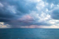 Rain above the sea. Sunset seascape Stock Images