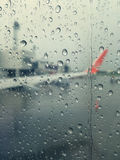 Rain with a Airplane wing. Stock Photos