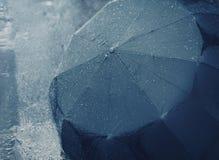 Rain, autumn, weather concept - rainy, wet umbrella Stock Image