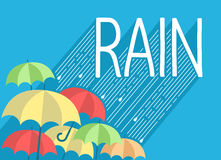 Rain background with stylish text and umbrellas Stock Image