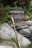 Rain barrel and hiking stick Stock Photo