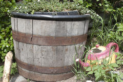 Rain barrel and teapot Royalty Free Stock Photos