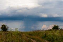 Rain beginning behind the horizon in the village royalty free stock photos
