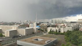 The rain begins. Heavy cloudiness and heavy rain over the city center.