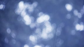 Rain on blue background stock video footage