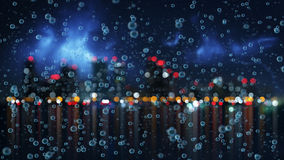 Rain and blurred night city. On background Royalty Free Stock Photo