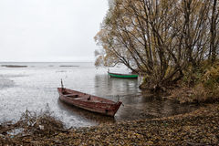 Rain and boats. Till next spring of the boat put in smooth water Royalty Free Stock Image