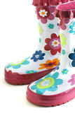 Rain boots. Fun little girl's colorful flower rain boots isolated on white Royalty Free Stock Photography