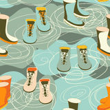 Rain boots in a puddle Royalty Free Stock Photography