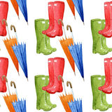 Rain boots and umbrellas on white background, seamless watercolor pattern. Rain boots and umbrellas on white background Royalty Free Stock Images