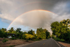 Rain bow over  the road Stock Images
