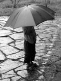 Rain boy. A boy under an umbrella in rainy weather Royalty Free Stock Photo