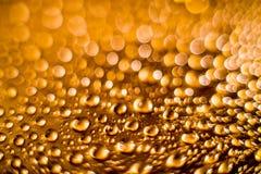 Rain burbles and sun. Rain drops burbles texture and bokeh background in orange Stock Photo