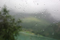 Rain on bus window. Blur view with raindrops on bus window Stock Image