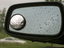 Rain on car mirror 20 Stock Images
