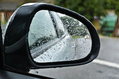 Rain on a car mirror Stock Photography