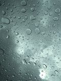 Rain on car window. Rain falling on car sunroof Royalty Free Stock Photo
