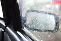 Rain on the car window. royalty free stock image
