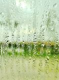 Rain. In the car rain window water droplet green plan cancel roll your window stock photos