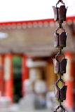 Rain catcher. Small bells that catch rain hanging from a japanese temple Royalty Free Stock Photo