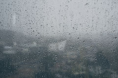 Rain caught at the window glass Royalty Free Stock Image
