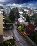 The rain in the city. Rain in the city near Black sea. Sun and rain Stock Images