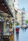 Rain on city street, person gets cold Royalty Free Stock Photo