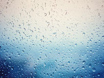 Rain in city, water drops on wet window glass Royalty Free Stock Photography