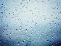 Rain in city, water drops on wet window glass Stock Image