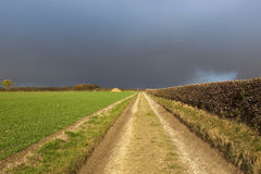 Rain cloud and bridleway Royalty Free Stock Photography