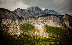 Rain Cloud Mountain. Dark clouds over a talk mountain ridge Royalty Free Stock Image