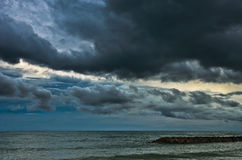 Rain cloud over the sea. Big dark rain cloud over the sea Royalty Free Stock Photos