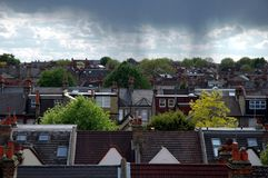 Rain clouds. Over the roof tops in london, england Royalty Free Stock Images