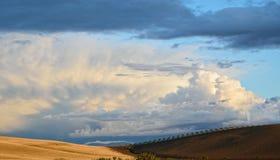 Rain clouds above the fertile hills Stock Photos