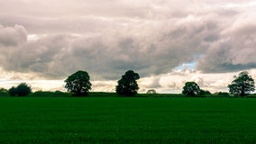 Rain Clouds Above Fields in Somerset England. Minimalist Landscape Photography royalty free stock photos