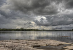 Rain clouds above the lake. In Finland Stock Images