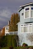 Rain Clouds behind Homes Royalty Free Stock Photo