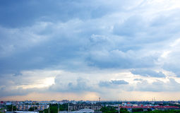 Rain clouds in city Stock Image