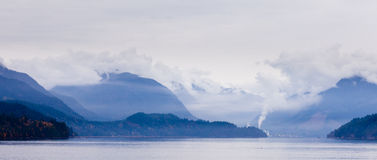 Rain clouds on coastal mountain ranges BC Canada Royalty Free Stock Images