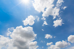 Rain clouds are coming on the colorful blue sky with real ray of the sun Stock Photography