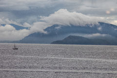 Rain Clouds and Fog--Gulf Islands, Vancouver Island. Rain clouds and fog hug the Gulf Islands near North Saanich, Vancouver Island in British Columbia. British Royalty Free Stock Photo