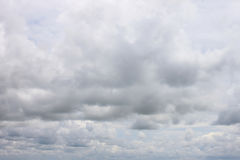 Rain clouds forming in the sky in concept of climate. Stock Images