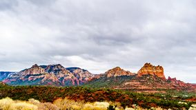 Rain clouds hanging over the red rocks of Schnebly Hill and other red rocks at the Oak Creek Canyon royalty free stock photography