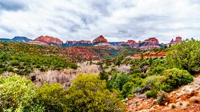Rain clouds hanging over the red rocks of Schnebly Hill and other red rocks at the Oak Creek Canyon viewed from Midgely Bridge stock photography