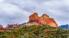 Rain clouds hanging over the red rocks of Schnebly Hill and other red rocks at the Oak Creek Canyon viewed from Midgely Bridge royalty free stock photo