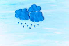 Rain clouds made from plasticine Stock Images